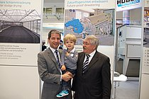 Future-proof: Three generation of the Huber family at their IFAT booth - CEO Georg Huber, his son Carl and head of supervisory board Dr.-Ing. E.h. Hans G. Huber